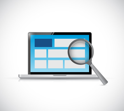 image of a magnifying glass in front of a website on a computer screen